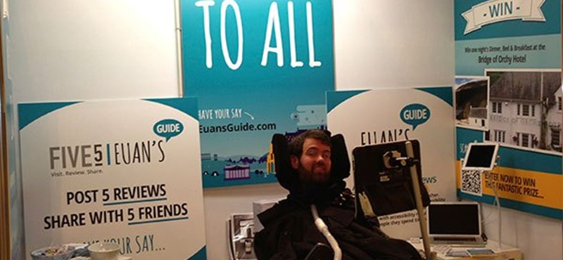 A photo of Euan at the Euan's Guide stall.