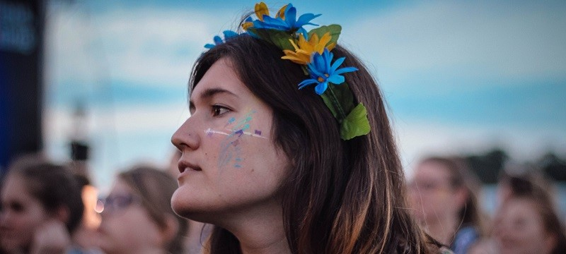 Photo of a girl with flowers in her hair.