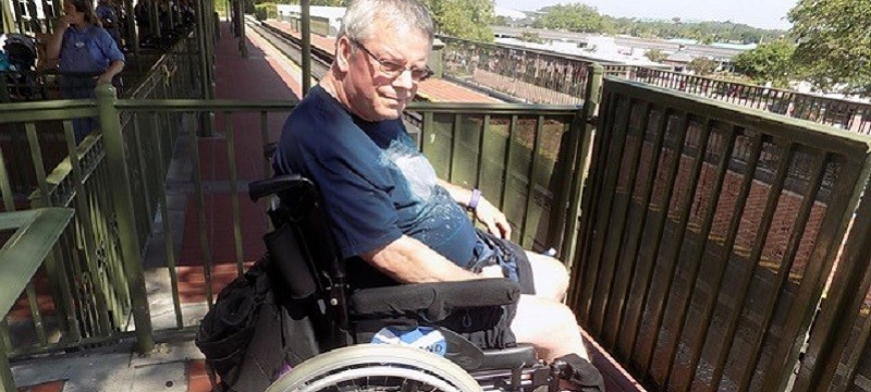 Photo of Neil waiting to board the train.