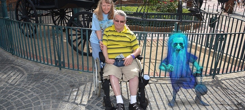Neil and Brenda with haunted house ghost.