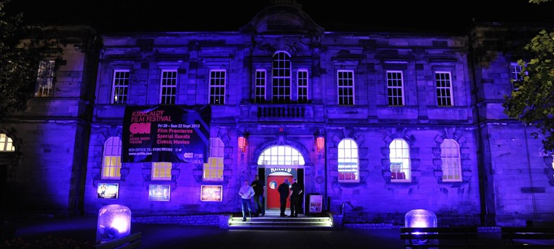 Photo of Adam Smith Theatre at night.