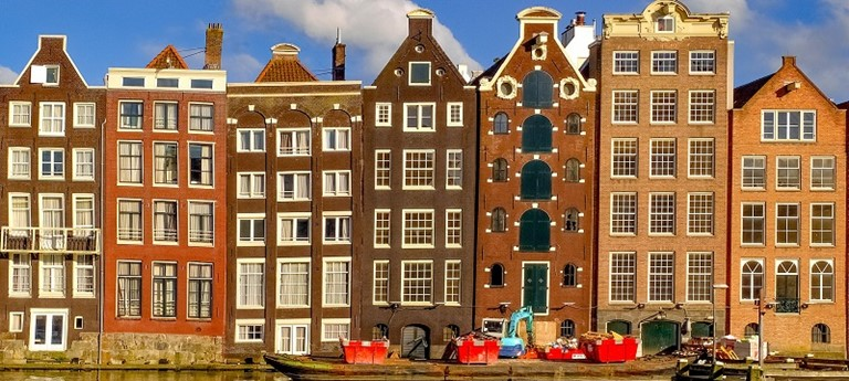 Photo of tall, crooked buildings in Amsterdam.