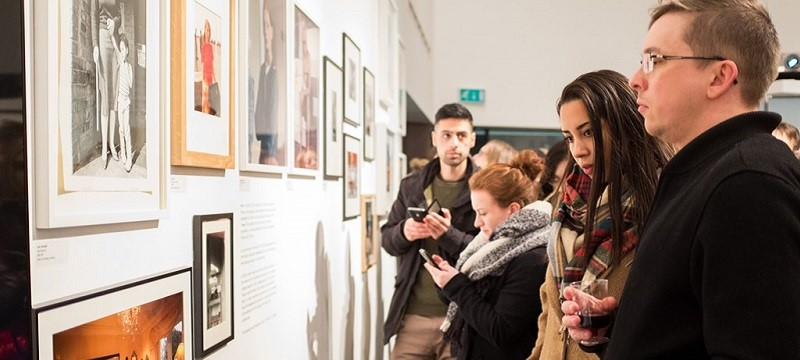 Photo of visitors to the Open Eye Gallery.