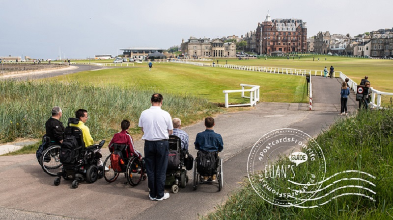 Postcard of wheelchair users at Old Course in St Andrews.