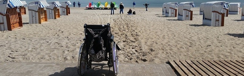 Photo of a wheelchair on a beach.