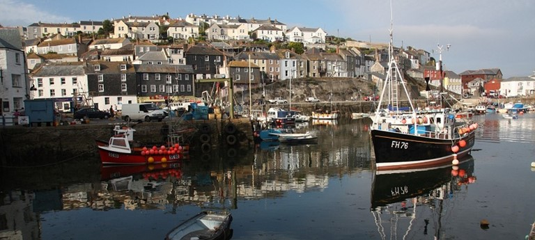 Photo of boats along a Cornish harbour.