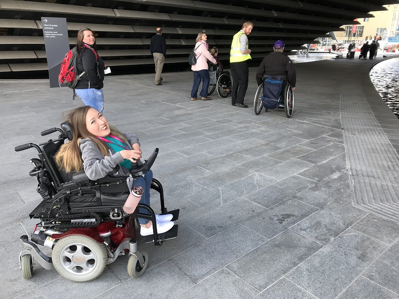 Photo of Claire outside the V&A Dundee.