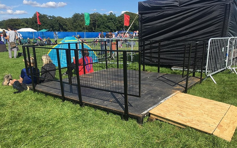 Photo of a low viewing platform at a music festival.