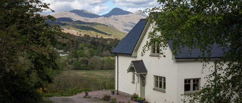 Photo of Bluebell Croft exterior with mountain view.