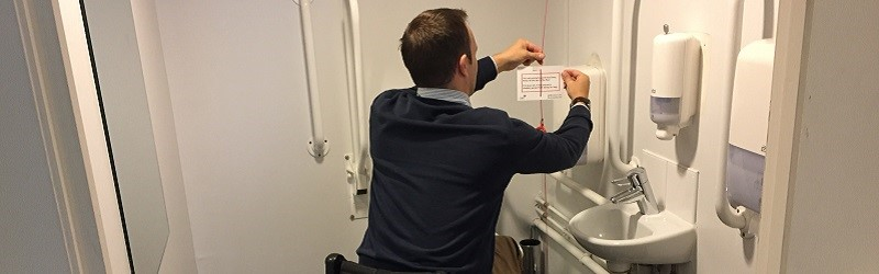 Photo of Ryan attaching Red Cord Card.