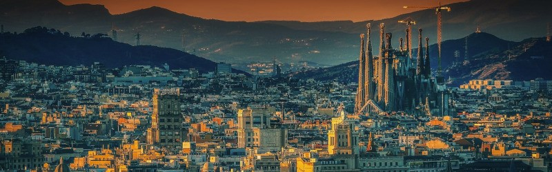 Photo of Barcelona's skyline, taken at sunset.