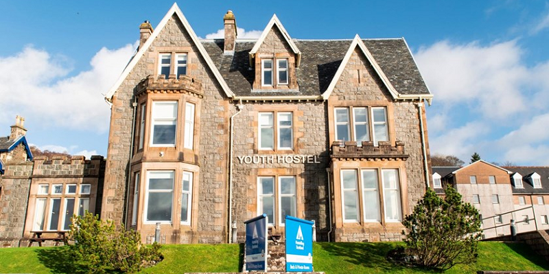 Photo of Oban's Youth Hostel's facade on a sunny day.
