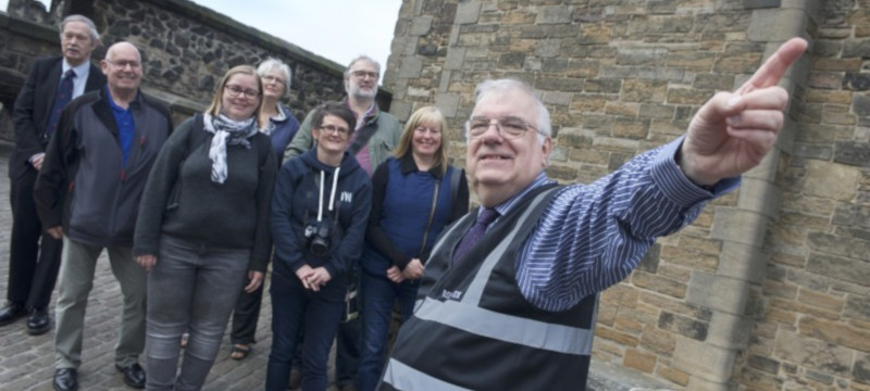 John Hay pictured with a tour group at Edinburgh Castle.