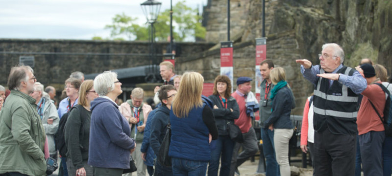 Photo of John May, BSL tour guide leading a tour at Edinburgh Castle.