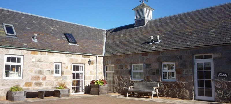 Photo showing the exterior of a cottage at Crathie Opportunity Holidays.