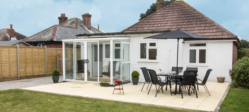 Photo of the back patio of a cottage at Our Bench Cottages, Lymington.