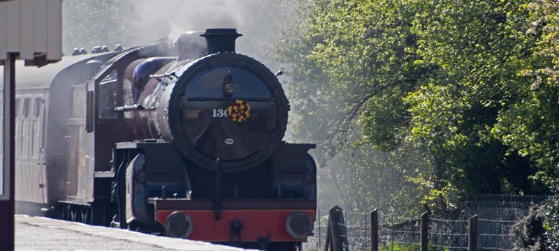 Photo of a steam locomotive pulling passenger carriages on the East Lancs Railway.