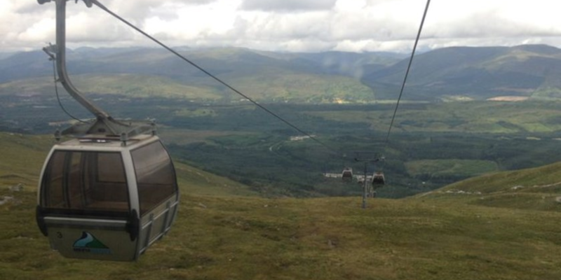 Photo of the Nevis Range Gondola in operation with mountains visible in the distance.
