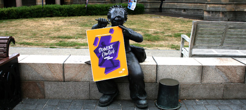 Photo of Euan's Guide Dundee and Angus travel guide with Oor Wullie.