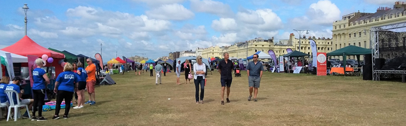 Photo:  Early morning view of Hove Lawns, with stalls and stage, with the first visitors arriving