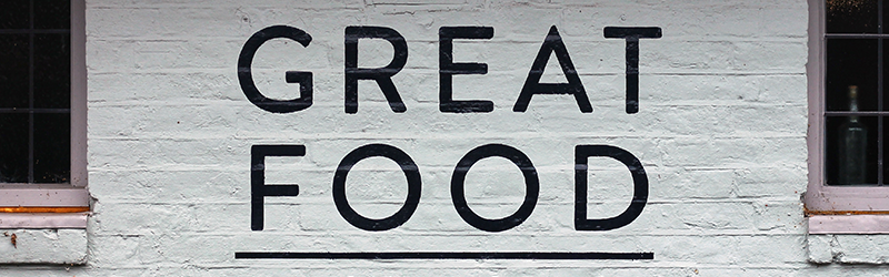 Brick wall with the text 'great food' written on it