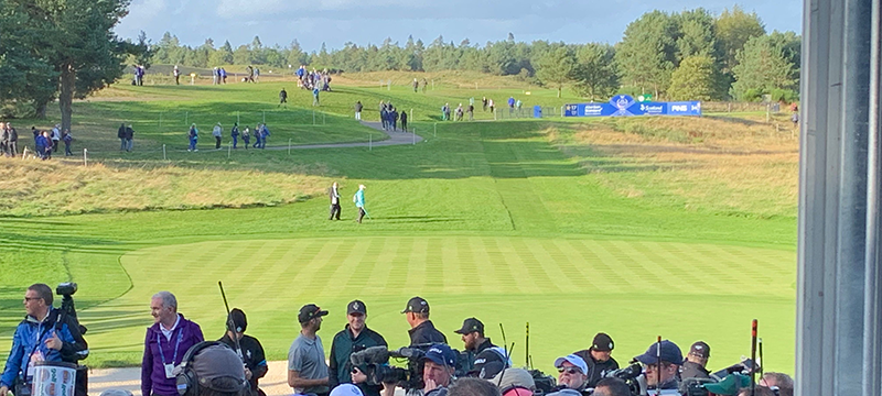 Photo of people gathering to watch the golf at the Solheim Cup © Euan's Guide.