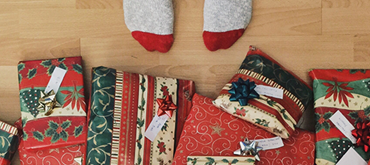Generic image of wrapped presents on a hardwood floor