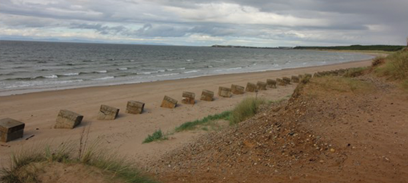 Image of beach and water on an overcast day