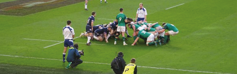 Image of Ireland and Scotland rugby teams in a scrum.
