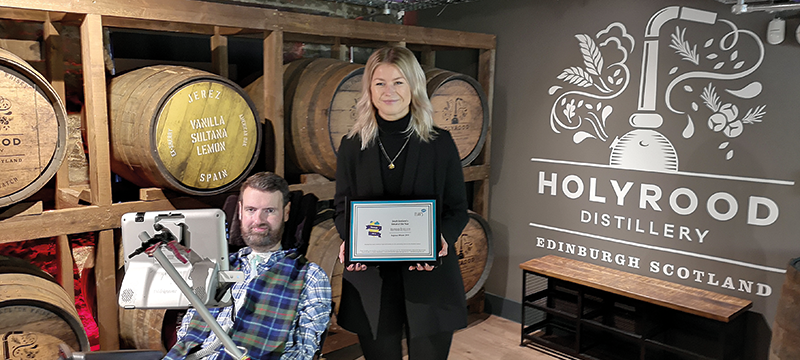 Image of Euan presenting the award to Holyrood Distillery