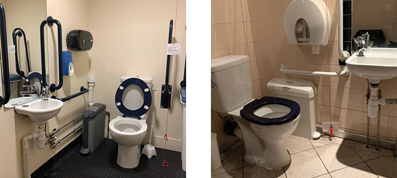 Image of two accessible toilets both with red cords hanging low to the floor.