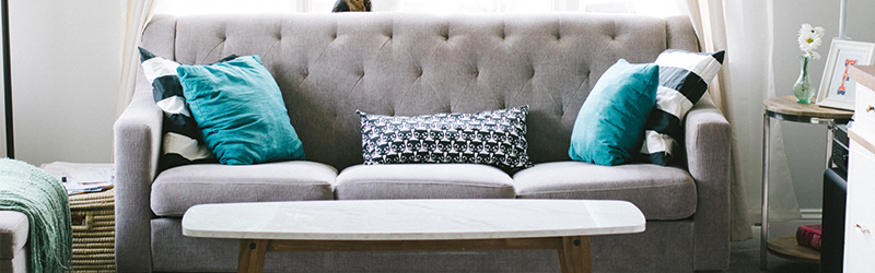 Grey sofa in a bright room.