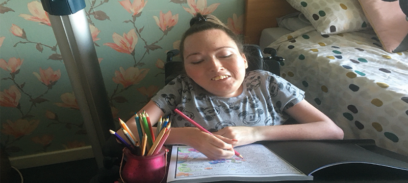 Image of Claire colouring in at home.