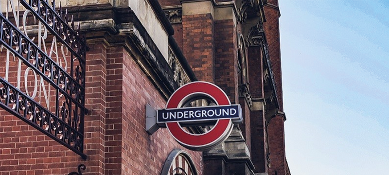 A red brick building with the London Underground sign attached.