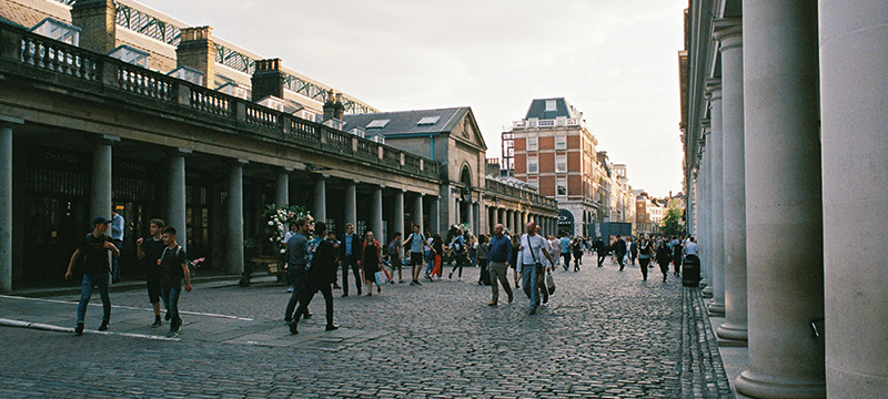 Image showing people on a cobbled street in Covent Garden, London.