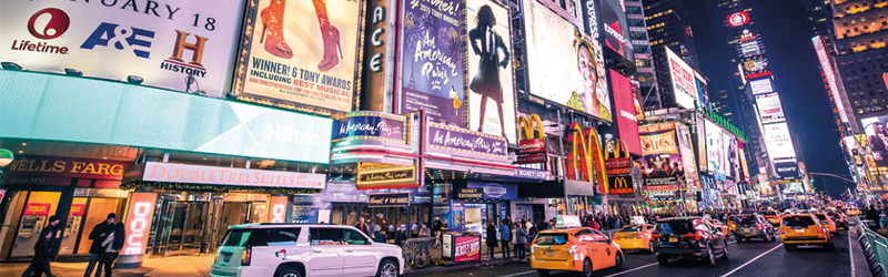 Billboards in New York City showing adverts for Broadway shows.