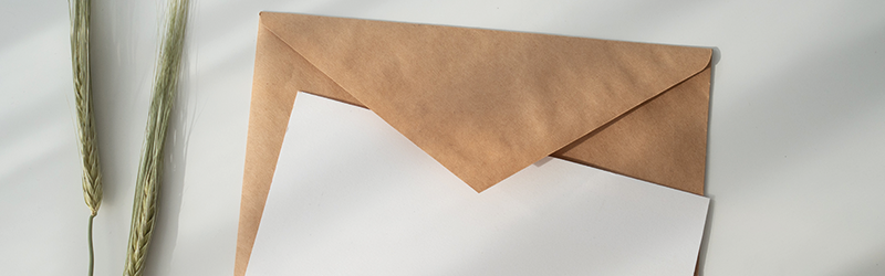 Image of a beige envelope covered by a plain white card.