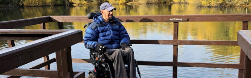 A powerchair user on a platform at Doune Ponds