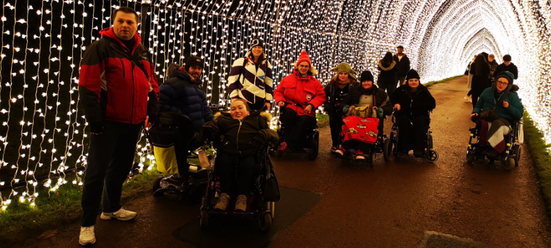 A group of people under a tunnel of lights.