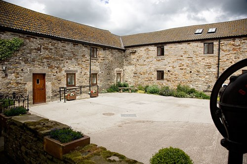 A photo of the outside of Old Byre Self Catering Cottage.