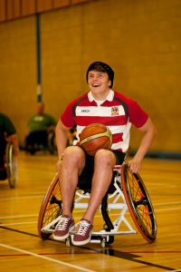 A photo of a wheelchair user playing basketball
