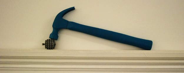 A photo of a hammer on a wall.
