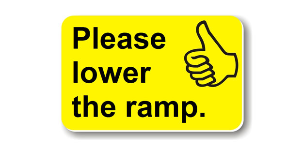 A photo of a card which says 'please lower the ramp'.