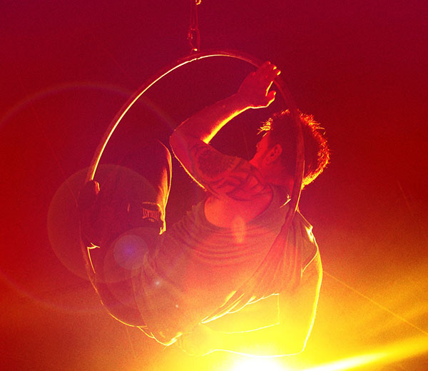 Photo of acrobat in a hoop suspended in mid air