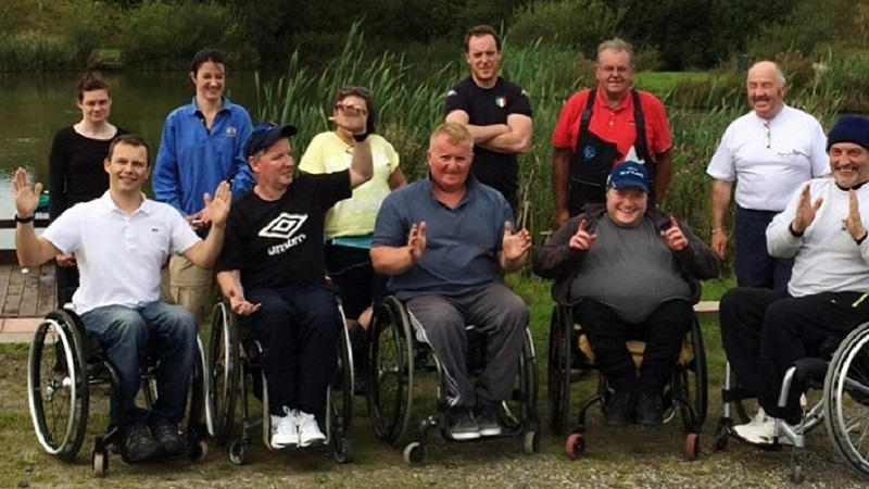 Photo of wheelchair users on a fishing trip.
