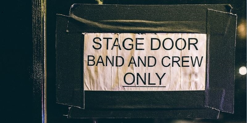 Photo of a stage door sign.
