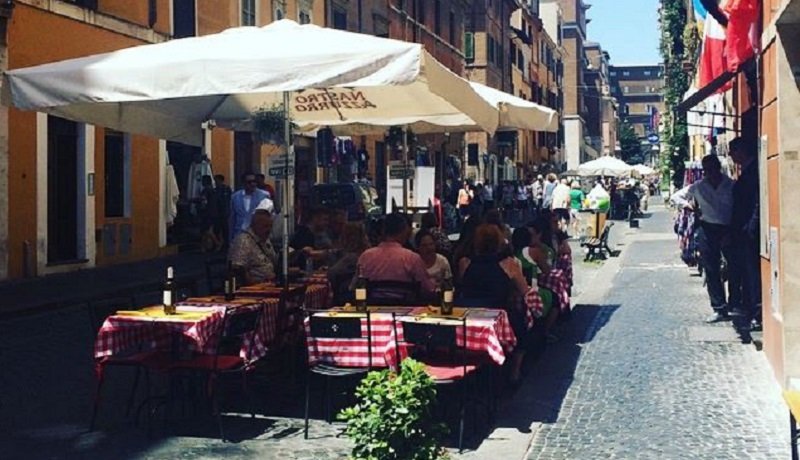 Photo of people eating outside in Rome.
