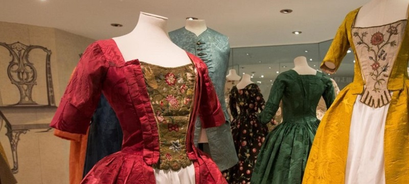 Photo of dresses at the Fashion Museum.
