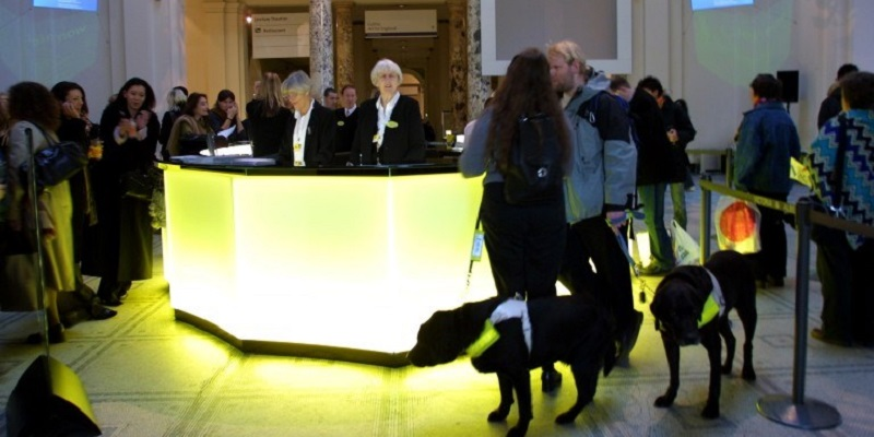 Photo of visitors with assistance dogs at V&A.