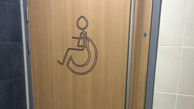 Photo of an accessible toilet door.
